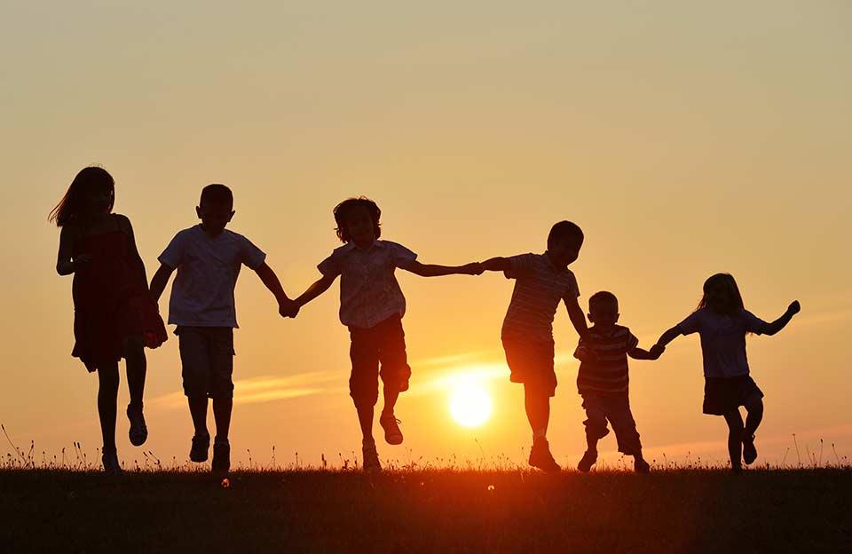 bigstock-Happy-children-silhouettes-on--63292741